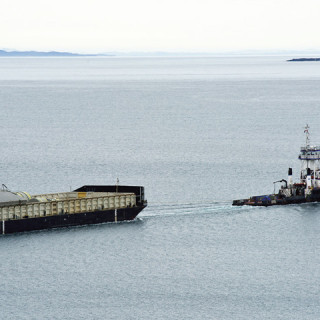 McKeil's tug and barge sailing the shores of Newfoundland and Labrador